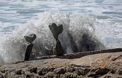Rock balancing art on beach rocks in Laguna Beach, California. Royalty Free Stock Photos