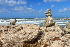 Rock balancing on the cliff Stock Image