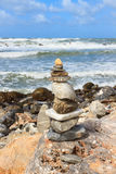 Rock balancing on the cliff Stock Photos