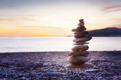 Balancing stone on top of each other stock photography