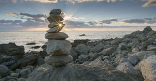 Rock Balancing. At sundown at Rocken End, Isle of Wight, England Stock Images