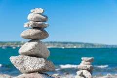 Rock balancing in Vancouver stone stacking garden. & x28;English Bay Beach& x29 Stock Photography