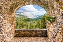 Rock balcony overlooking a beautiful green valley with forest royalty free stock photos