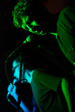 Rock band. Razvan Moldovan from Partizan band performing live in a club Royalty Free Stock Image