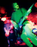 Rock band atmosphere - grainy image. Grainy blurry atmospheric abstract noisy hazy image of a bass player and guitar player rippin' thru songs. Shot with 3200 stock images