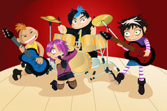 Rock band of four little kids Royalty Free Stock Image