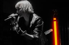 Rock Band Lead Singer Wearing Black Jacket and Wireless Microphone Stock Images