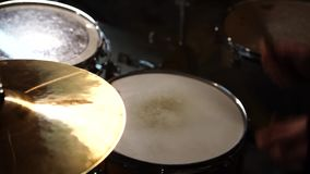 Rock band performing in a nightclub. Close-up of drummer.Rock band. stock footage