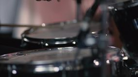 Rock Band Performing on Stage. Drummer Plays Drums Kit. Drummer Hand Silhouette With Drumstick. Rock Band Performing on Stage stock video footage