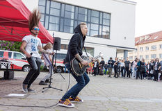 Rock band performing on the street. Vilnius, Lithuania - May 21, 2016: Rock band performing on the street at traditional street music day in Vilnius, Lithuania Royalty Free Stock Images
