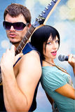 Rock Band Performing Together back to back Stock Photography