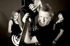 Rock band in studio Stock Photo