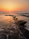 Rock in Barrika beach at sunset Royalty Free Stock Photos