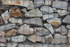 Rock basket. (gabions) filled with quartzite stone Stock Photography
