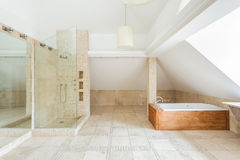 Rock bathroom. Deisgn of rock bathroom with wooden bathtub stock photography