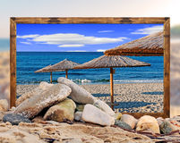 Rock on the beach with beautiful beach picture frame and blurred Stock Photo