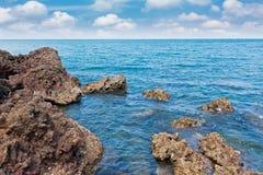Rock beach on daylight Royalty Free Stock Photo