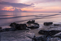 Rock beach on morning time Royalty Free Stock Photo