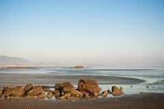 Rock beach of Qingdao. Rock beach on beach sea background Stock Photo