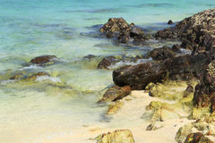 Rock beach with sea at Koh Khai Nok Royalty Free Stock Photo