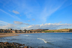 Rock and beach at Stonehaven bay on Sunny day Stock Photography