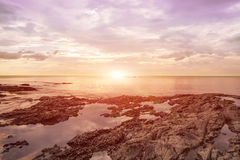 Rock on the beach sunset seascapes Stock Photography