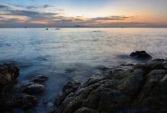 Rock beach sunset skyline Stock Photo