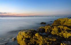 Rock beach sunset skyline Royalty Free Stock Image