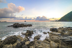 Rock beach and wave Stock Photography