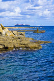 Rocky coastline of Malta. With container ship sailing in background, Maltese Islands Stock Images