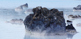 Rock at Blue Lagoon geothermal water in Iceland Stock Images