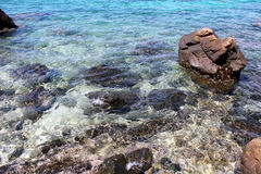 Rock and blue sea. Beautiful rock and blue sea in Thailand. clear water Royalty Free Stock Photos