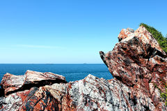 Rock, blue sea and blue sky. Beautiful rock, blue sea and blue sky in Thailand Royalty Free Stock Photo