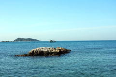 Rock, blue sea and blue sky. Beautiful blue sea in Thailand. Clear water and rock Stock Image