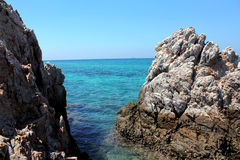 Rock, blue sea and blue sky. Beautiful rock, blue sea and blue sky in Thailand. clear water Royalty Free Stock Photography