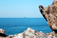 Rock, blue sea and blue sky. In Thailand Stock Photo