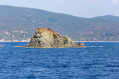 Rock in the blue sea Stock Photography