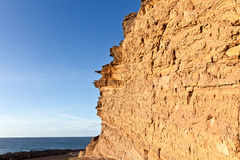 Rock with blue sky at the coast in Lanzarote Royalty Free Stock Photos