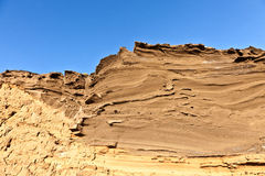 Rock with blue sky at the coast in Lanzarote Stock Image