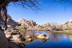 Rock boulders reflected in the calm waters of Barker Dam, Joshua Tree National Park, south California stock photography