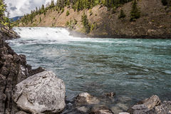 Rock by the Bow River Waterfall Royalty Free Stock Photos