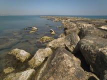 Rock Breakwater. Leading into a calm sea Royalty Free Stock Photos