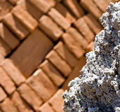 Rock with brick background Royalty Free Stock Photography
