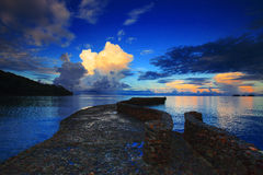 Rock bridge into blue sea against beautiful morning light sky an Royalty Free Stock Photo