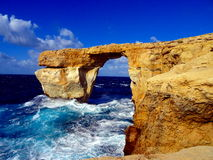 Rock bridge on the sea. Natural rock bridge on the sea Royalty Free Stock Photography