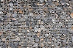 Rock in cage. Support wall Stock Photography