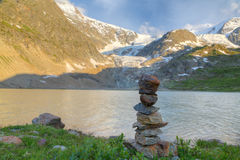 Rock cairn mark at glacier lake Royalty Free Stock Photo