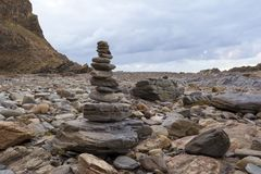 Rock Cairn, Second Valley, South Australia, Fleurieu Peninsula. Rock cairn on the rocky beach at Second Valley, South Australia, as the sky starts to colour up Stock Photos