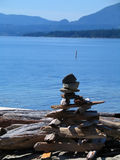 Rock cairn on shoreline Royalty Free Stock Photo