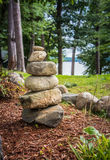 Rock Cairn. Stack of rocks, or a rock cairn, showing the way in front of a body of water Stock Images